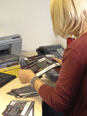 Debbie going through all reply cards that have been returned to us from the guilds